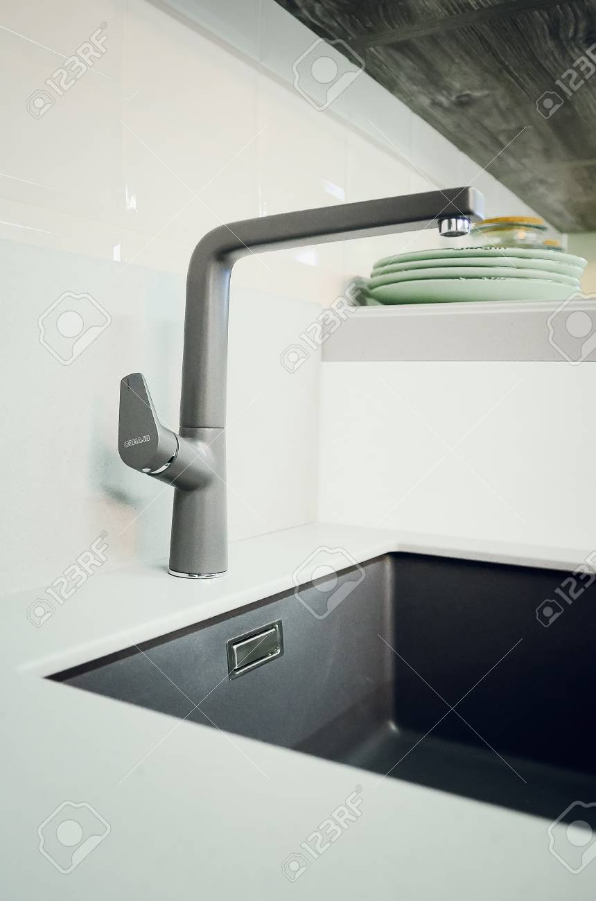 Full Size of A New Black Kitchen Sink Made Of Artificial Stone And A Faucet. The Concept Of Modern Kitchen Interior. Vertical Photography. Küche Küche Waschbecken
