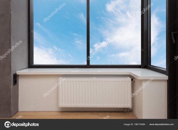 Medium Size of Heating White Radiator With Adjuster Of Warming In Living Room Under A Large Window. Wohnzimmer Heizkörper Wohnzimmer