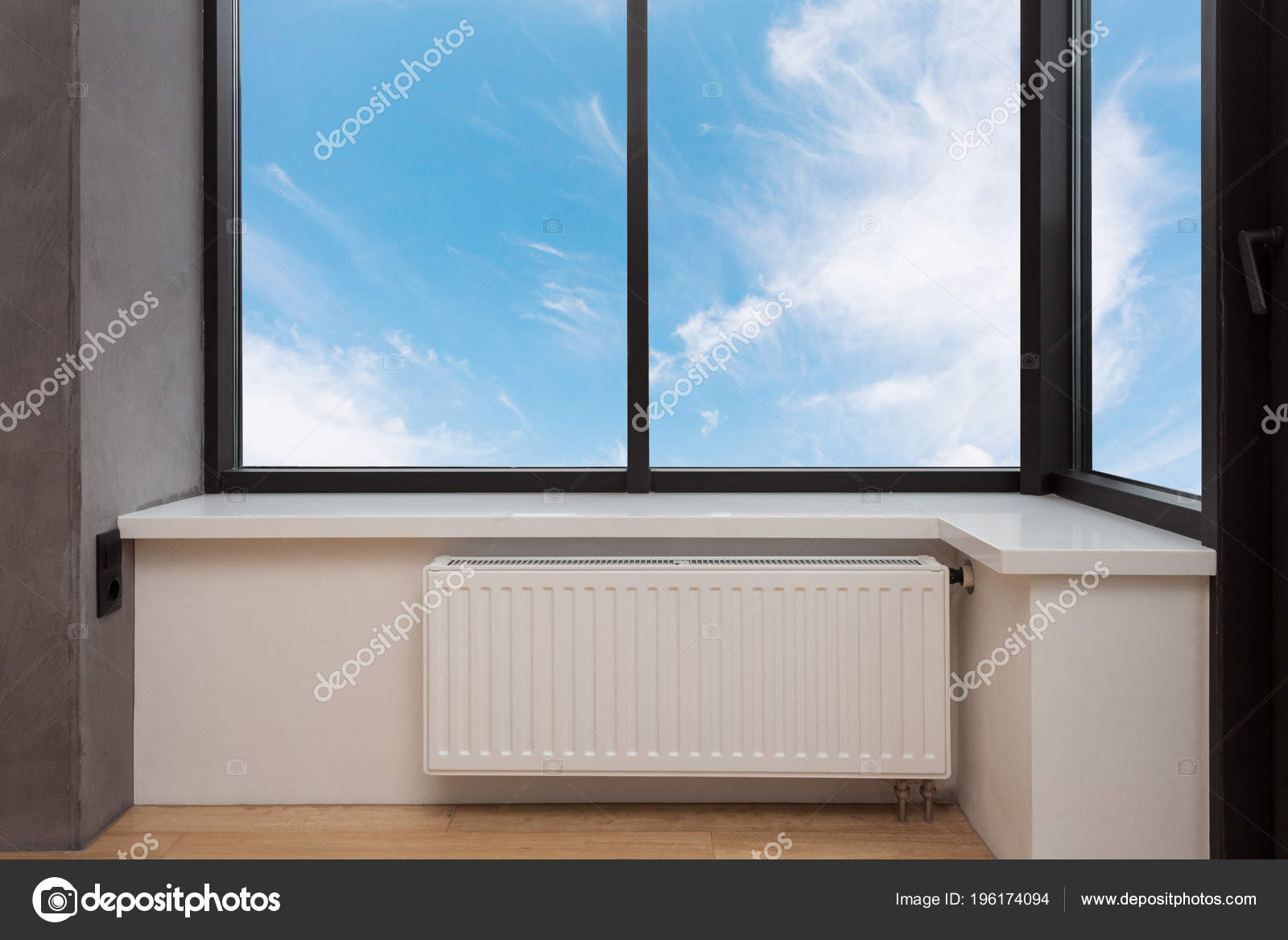 Full Size of Heating White Radiator With Adjuster Of Warming In Living Room Under A Large Window. Wohnzimmer Heizkörper Wohnzimmer