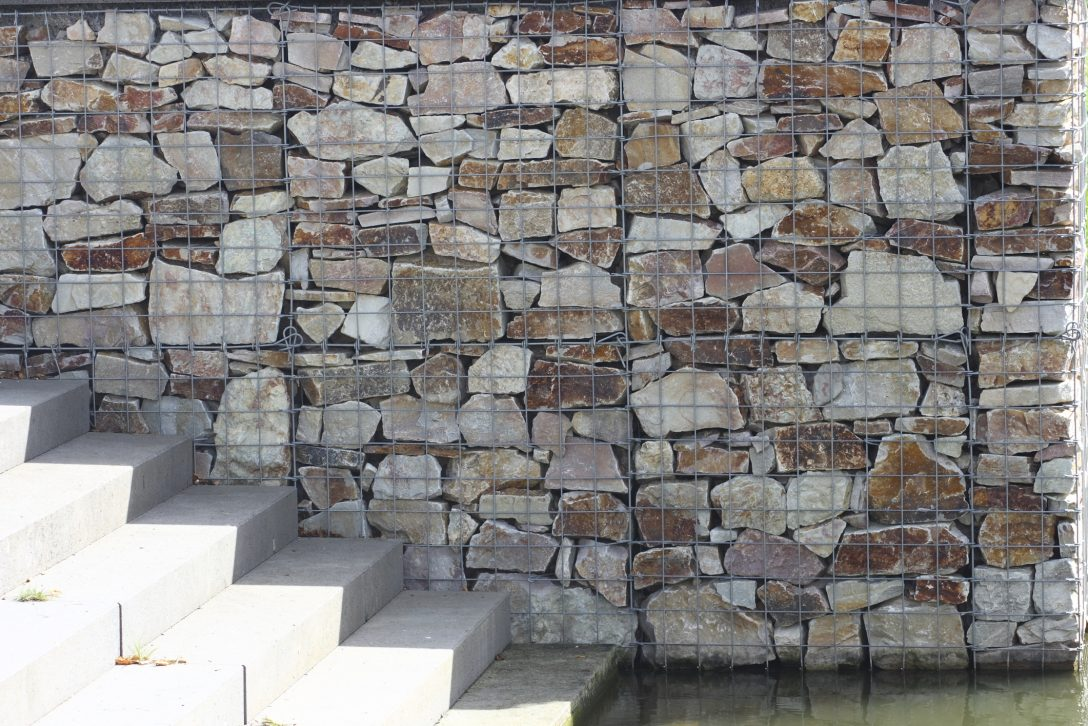 Large Size of Trennwand Garten Holz Sichtschutz Metall Glas Ikea Bauhaus Obi Wpc Stein Anthrazit Kaufen Rost Selber Bauen Kunststoff Hornbach Schweiz Gabionenwand Garten Trennwand Garten