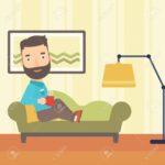 Liegen Wohnzimmer Wohnzimmer Ein Hipster Mann Mit Bart Auf Sofa Im Wohnzimmer Liegen Fürs Für Vorhänge Hängelampe Fenster Fliegengitter Schrankwand Lampe Lampen Stehlampe Teppich