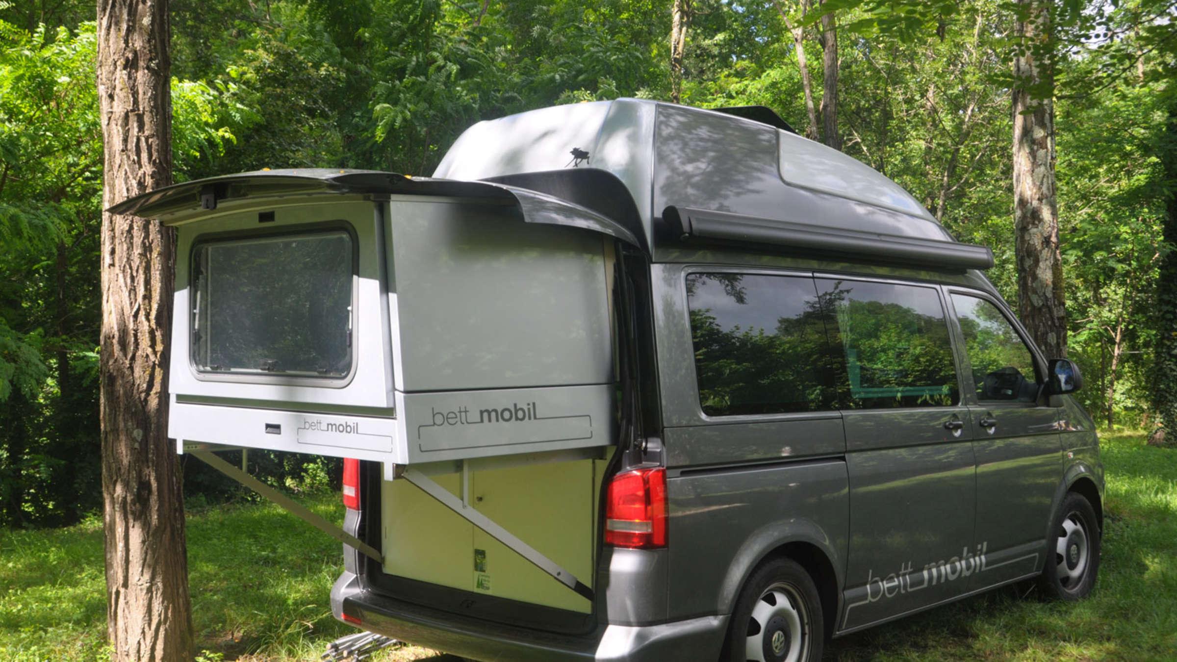 Full Size of Ausziehbett Camper Vw T5 Bett Mobil Von Hnle Auf Der Cmt 2015 Auto Mit Wohnzimmer Ausziehbett Camper