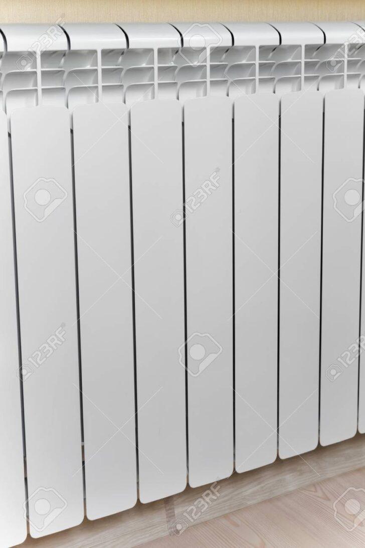 Medium Size of Heizkörper Für Wohnzimmer Heizung Wei Heizkrper Im Lizenzfreie Vorhänge Bad Griesbach Fürstenhof Stehlampe Körbe Schrankwand Rollos Fenster Kopfteile Wohnzimmer Heizkörper Für Wohnzimmer