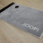 Teppich Joop Badteppich 281 Classic Kiesel Janning Steinteppich Bad Schlafzimmer Esstisch Betten Küche Badezimmer Wohnzimmer Für Teppiche Wohnzimmer Teppich Joop