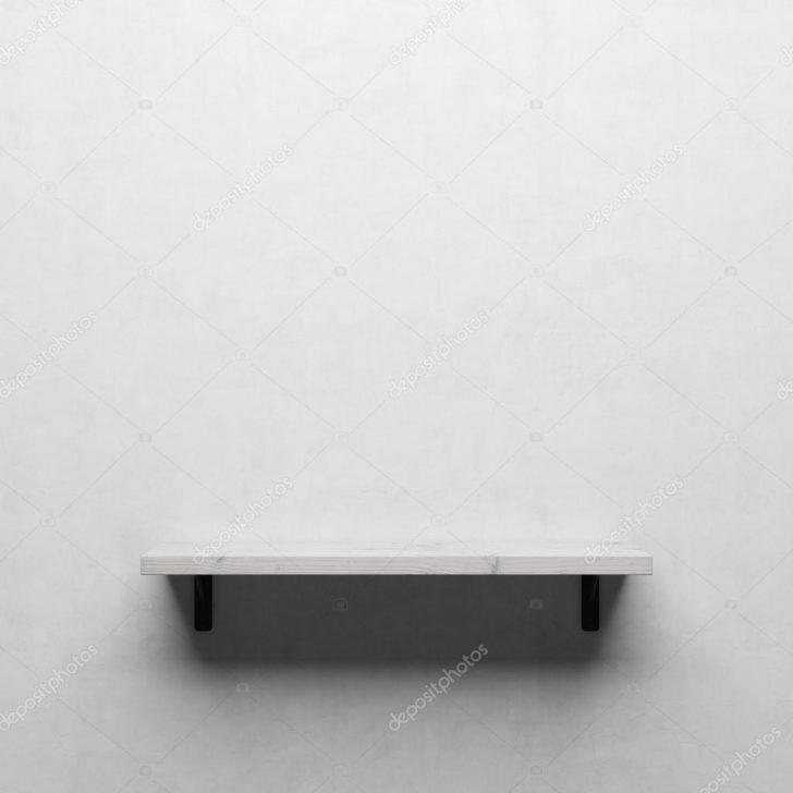 Medium Size of Weie Holzregal Auf Weien Wand Stockfoto Schlafzimmer Wandtattoos Bad Glaswand Küche Wandregal Wandleuchte Wandtattoo Sprüche Trennwand Garten Wandlampe Wohnzimmer Holzregal Wand