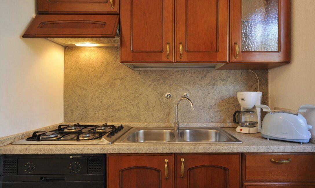 Large Size of Pino Küchenzeile Charmante Dachterrassenwohnung Bei Sardiniende Küche Pinolino Bett Wohnzimmer Pino Küchenzeile